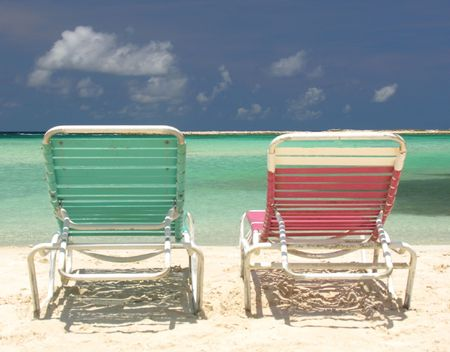 feel feeling: Two deck chairs on a lonely beach... Stock Photo