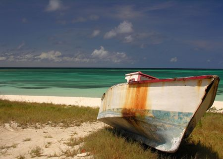bl: An old fishing boat on a caribbean beach...
