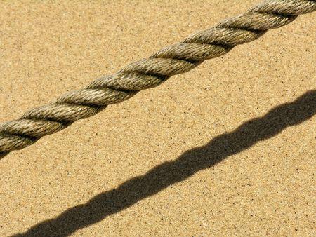 hawser: A rope on a sandy beach
