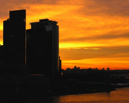 vertica: The skyline of uptown Manhattan at sunrise...