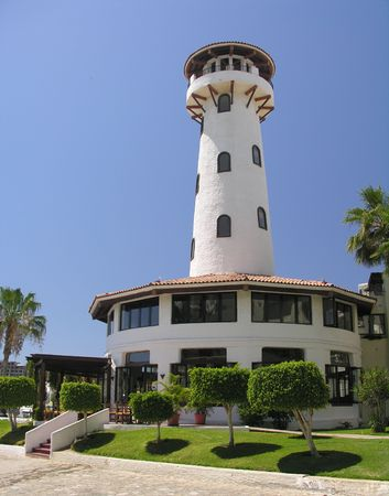 cabo: White lighthouse in the marina of Cabo San Lucas  Mexico
