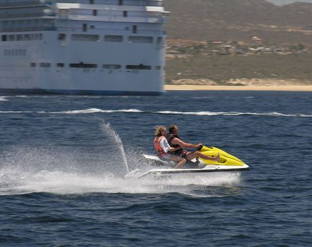 jetski: A man and a woman having fun by riding a jetski Stock Photo