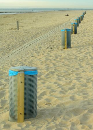 dirtied: Garbage cans on the beach...