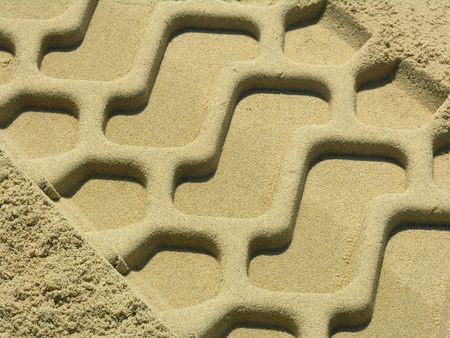 The trace of a tyre in the sand on the beach... Stock Photo - 243326