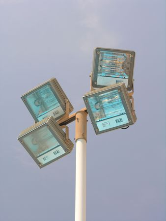 Floodlight lamps at day photo