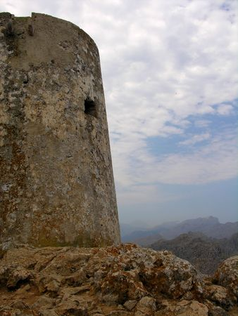 crown spire: Historical tower at the top of a mountain Stock Photo
