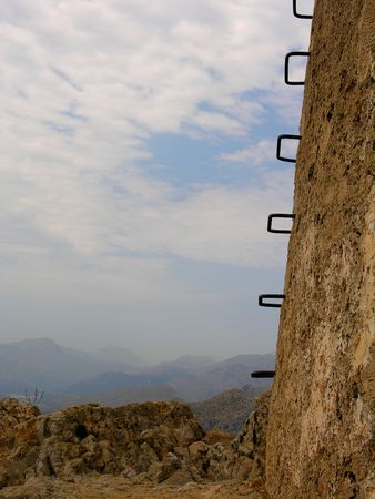 crown spire: Steps of a historical tower at the top of a mountain Stock Photo