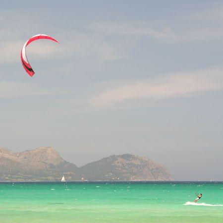 kiting: Kite surfer in the mediterranean sea