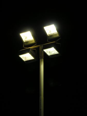 Floodlight lamps by night photo