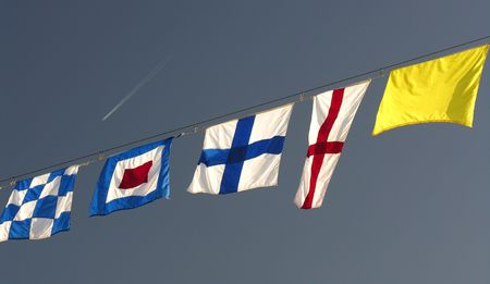 nautic: Colorful nautical flags hanging on a rope