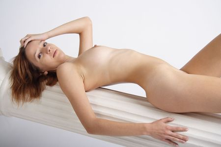 naked youth: Sexy beautiful young woman lying on a column