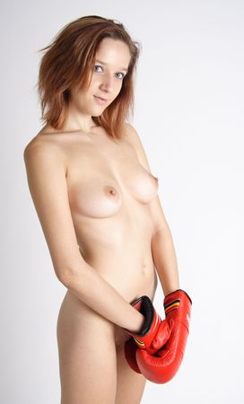 Pretty naked woman with red boxing gloves photo