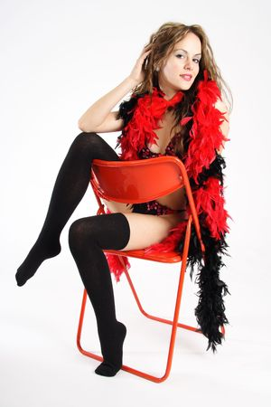 feather boa: Beautiful brunette woman dressed with black underwear and a red feather boa