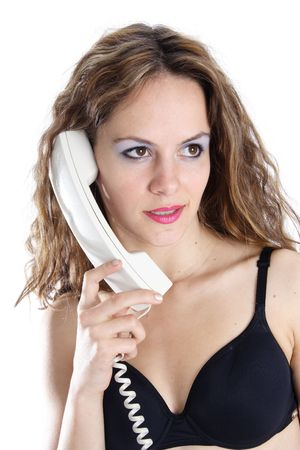 Beautiful brunette woman making a call with a white phone photo