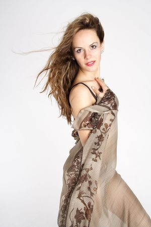 Beautiful brunette woman dressed with underwear and a beige foulard photo