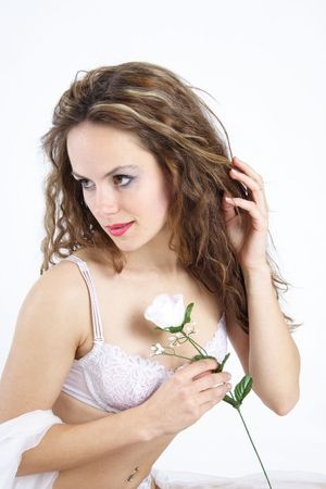 Beautiful brunette woman dressed with white underwear holding a white rose Stock Photo - 276799