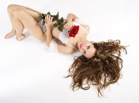 Beautiful brunette woman dressed with white underwear holding a white rose Stock Photo - 276796