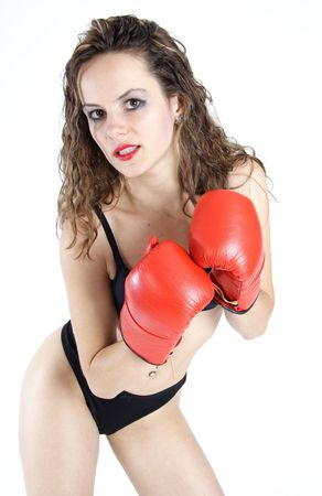 teen underwear: Beautiful brunette woman dressed with black underwear boxing with red gloves Stock Photo