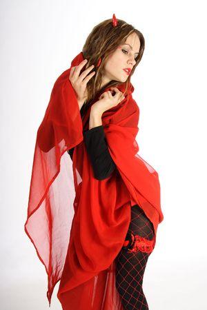 diable rouge: Belle brune femme habill�e comme un diable rouge  Banque d'images