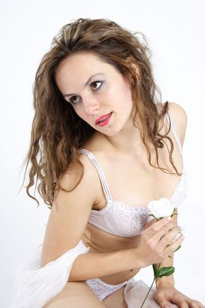 Beautiful brunette woman dressed with white underwear holding a white rose Stock Photo - 284809