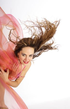 waft: Beautiful brunette woman with blowing hairs and foulards