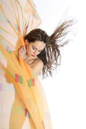 Beautiful brunette woman with blowing hairs and foulards photo