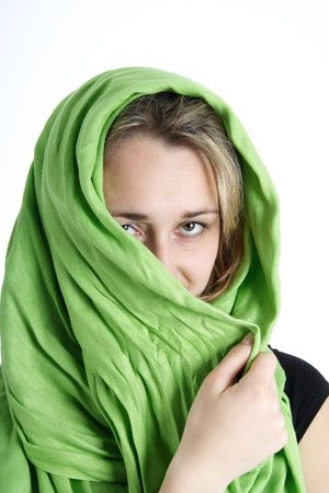 Portrait of a beautiful blond woman wrapped in a green foulard photo