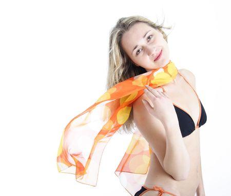 Beautiful blond woman holding an orange foulard photo