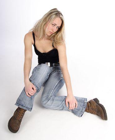 Beautiful sitting young blond woman photo