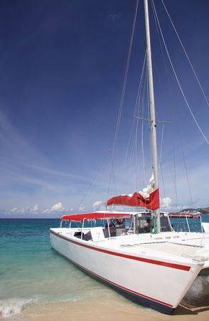 catamaran: Catamaran on a beautiful caribbean beach Stock Photo