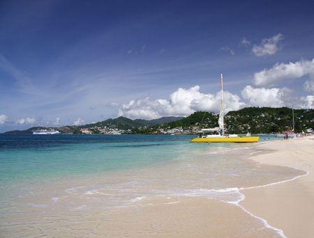 Catamaran on a beautiful caribbean beach photo