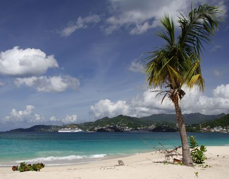 cruiseship: Beautiful caribbean beach with a cruiseship in the background
