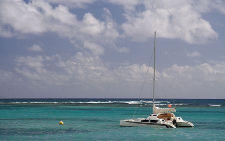 Sailing yacht in a blue caribbean lagoon photo