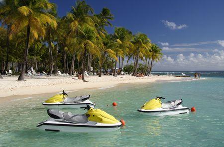 Beautiful caribbean lagoon with three jetskis Stock Photo