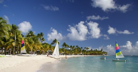 Beautiful caribbean lagoon with a colorful jolly boat photo