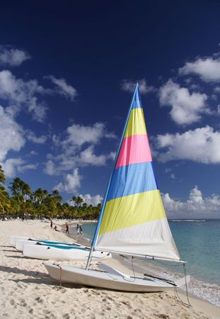 Beautiful caribbean beach with a colorful jolly boat photo