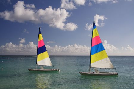 Beautiful caribbean lagoon with two colorful jolly boats photo