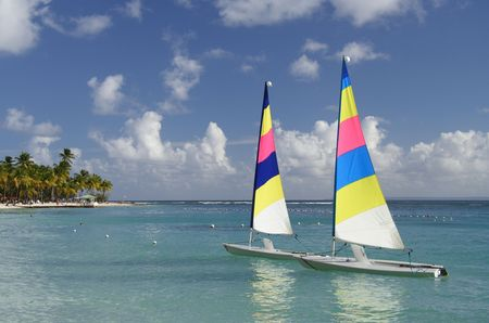 Caribbean lagoon with two colorful jolly boats Stock Photo - 426704