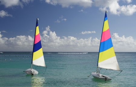Caribbean lagoon with two colorful jolly boats Stock Photo - 426699