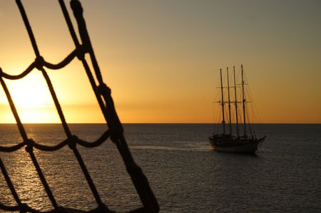 Mystic clipper at sunset with a ladder photo