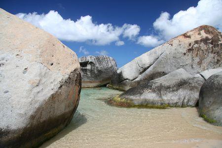 Granite rocks on a tropical beach photo