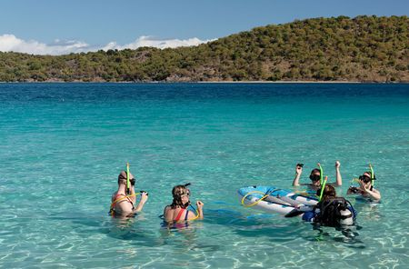 snorkling: People before snorkling in blue caribbean water