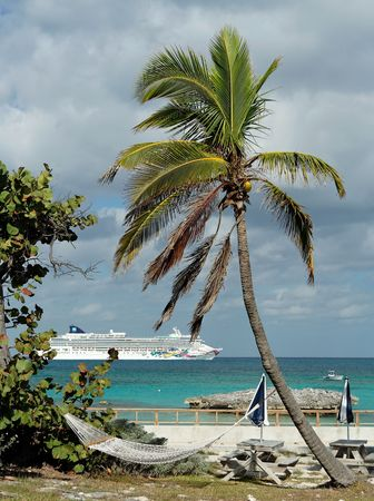 cruiseship: Palm beach with a cruiseship in the background Stock Photo