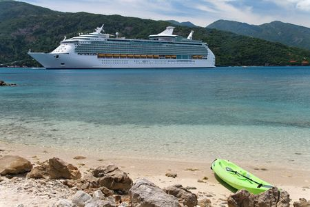Cruise ship with a kayak in the foreground Stock Photo