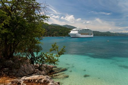 Cruiseship anchoring in a caribbean bay