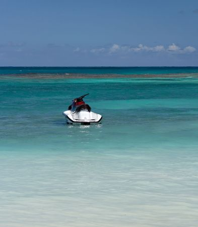 Blue caribbean water with jet ski