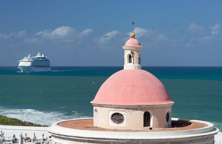 Historical caribbean chapel with cruise ship Stock Photo