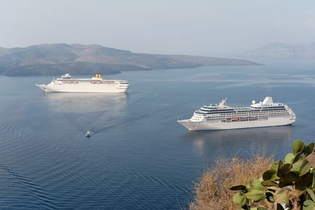Two cruise ships in a mediterranean bay