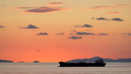 A freighter on the sea at sunset