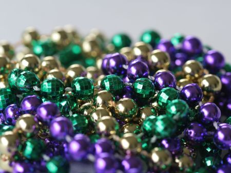 Close up photo of mardi gras beads